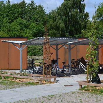 Boligkompleks i Ringe - overdækninger, stibomme, bænkesæt, mv.